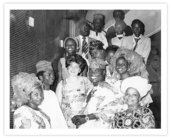 Hedy the founders daughter surrounded with African Customers